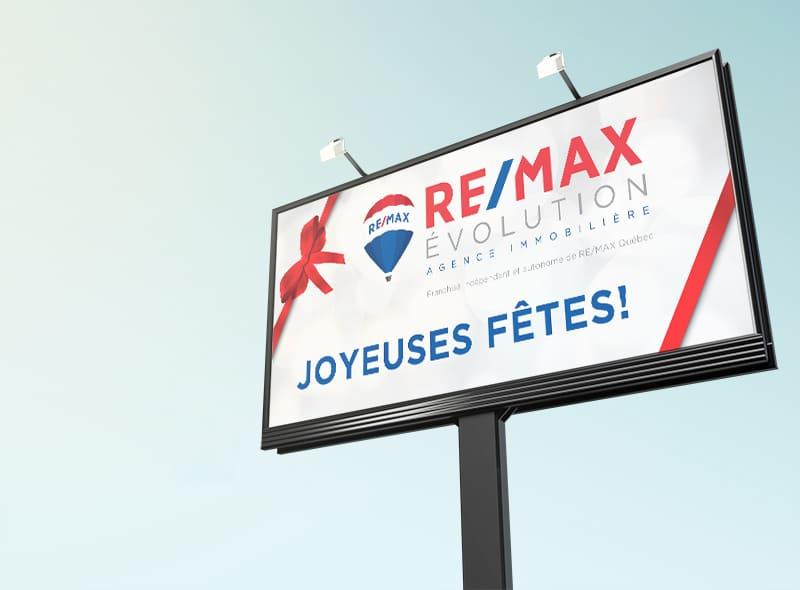 Remax Évolution - Panneau routier